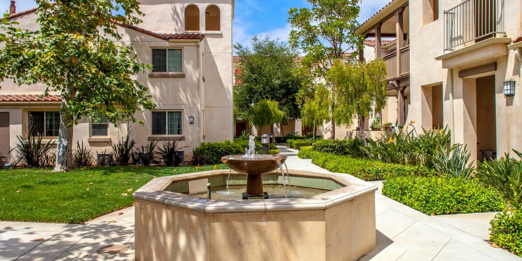 Fountain surrounded by well-maintained walkways and landscaping at Mission Hills in Camarillo, California