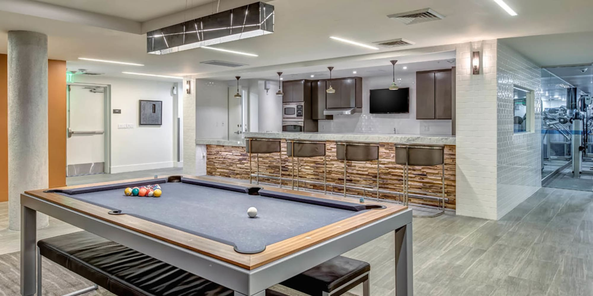 Game room with billiards and more in the clubhouse at Esprit Marina del Rey in Marina Del Rey, California