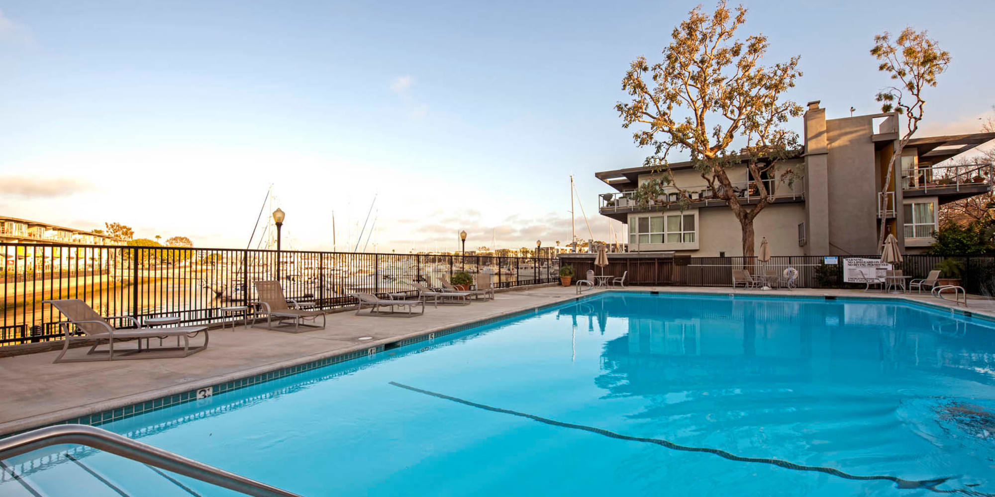 Late afternoon at a swimming pool overlooking the marina at The Tides at Marina Harbor in Marina Del Rey, California