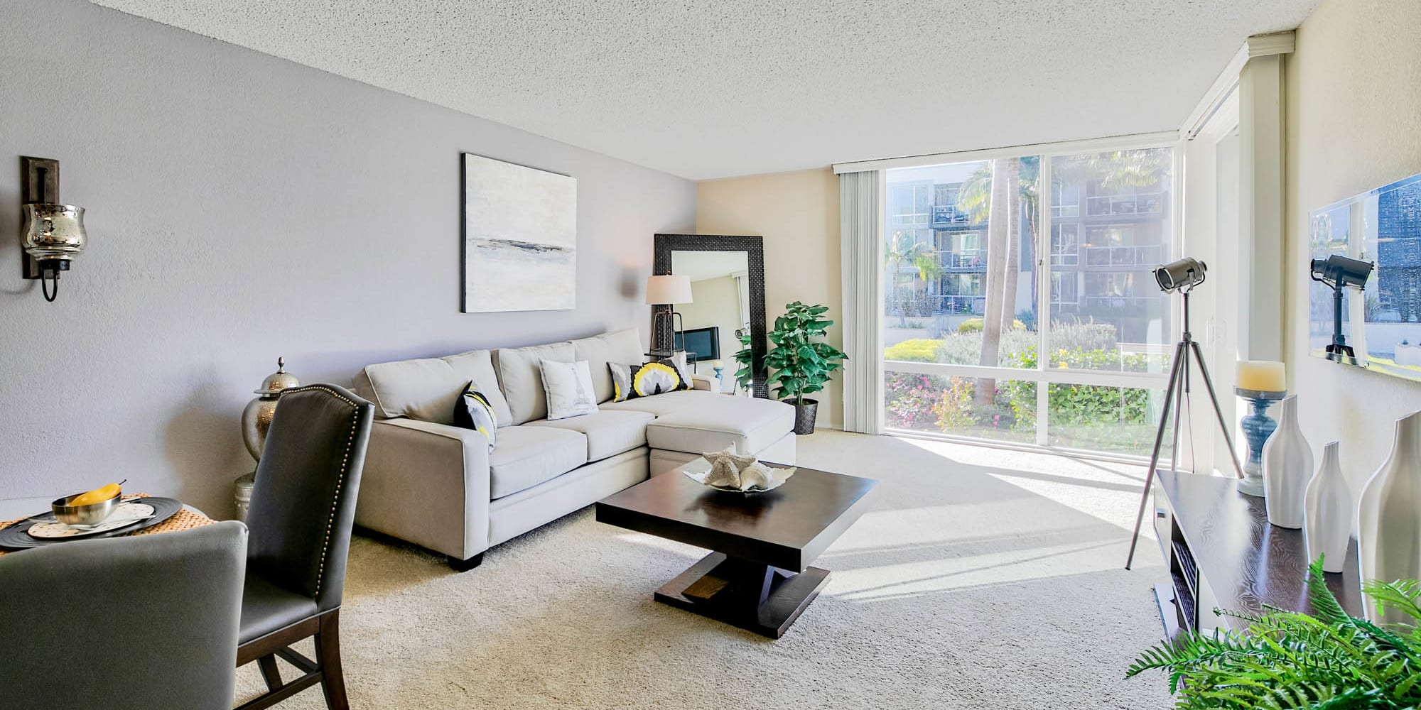Plush carpeting in the living space of a model home at Waters Edge at Marina Harbor in Marina Del Rey, California