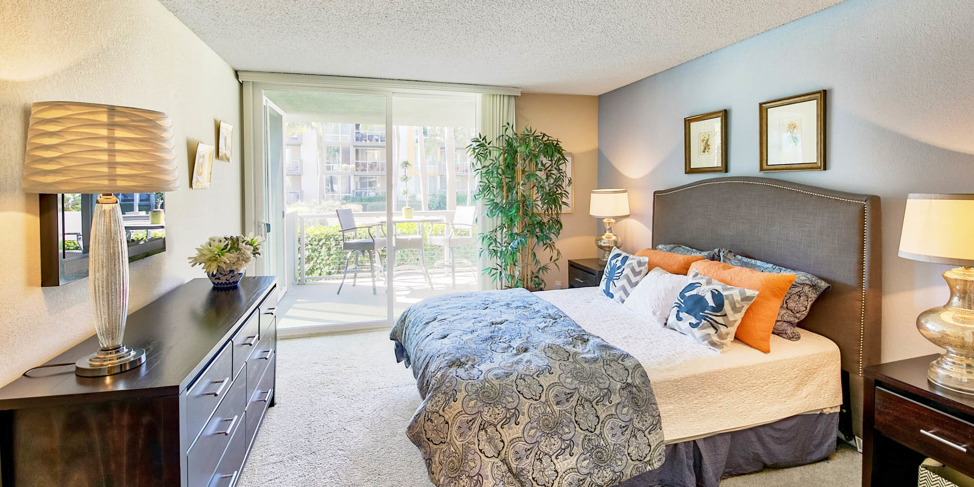 Spacious primary bedroom with plush carpeting in a model home at Waters Edge at Marina Harbor in Marina Del Rey, California