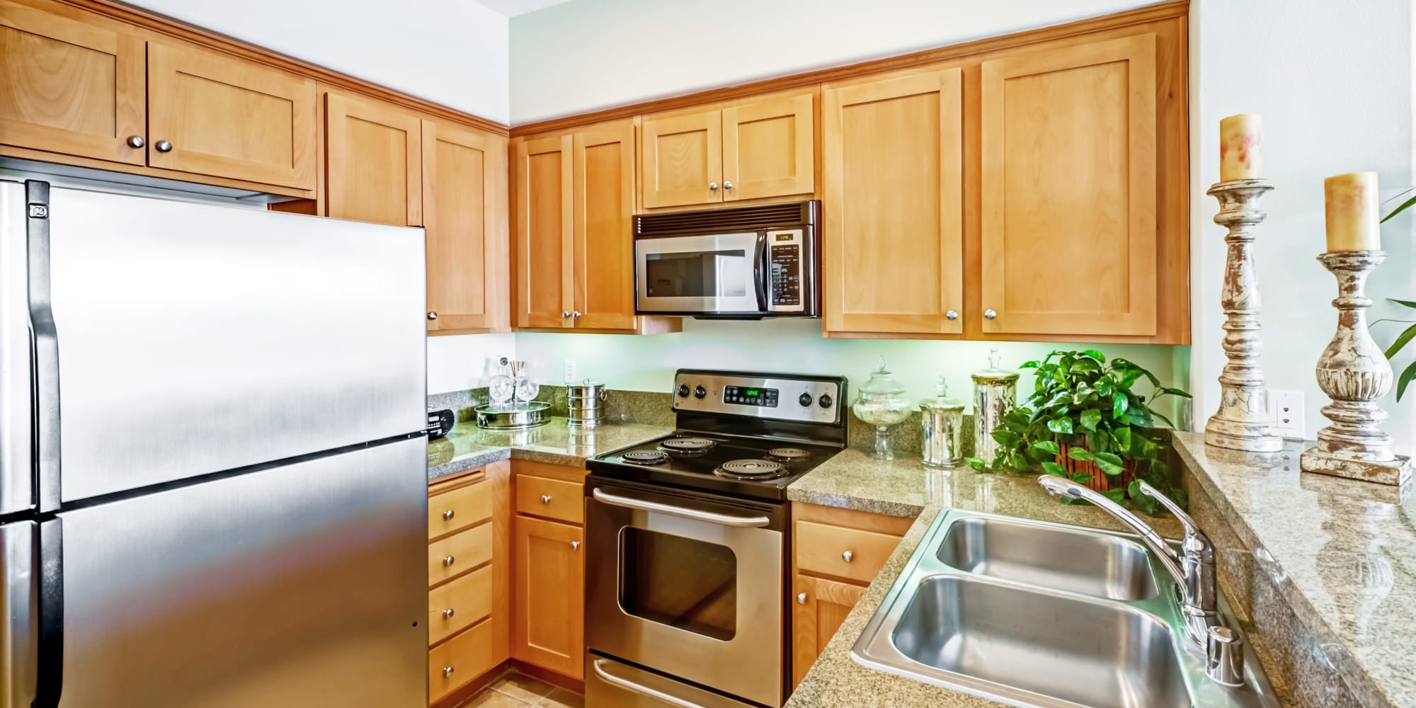 Stainless-steel appliances and granite countertops in a model home's kitchen at The Villa at Marina Harbor in Marina del Rey, California
