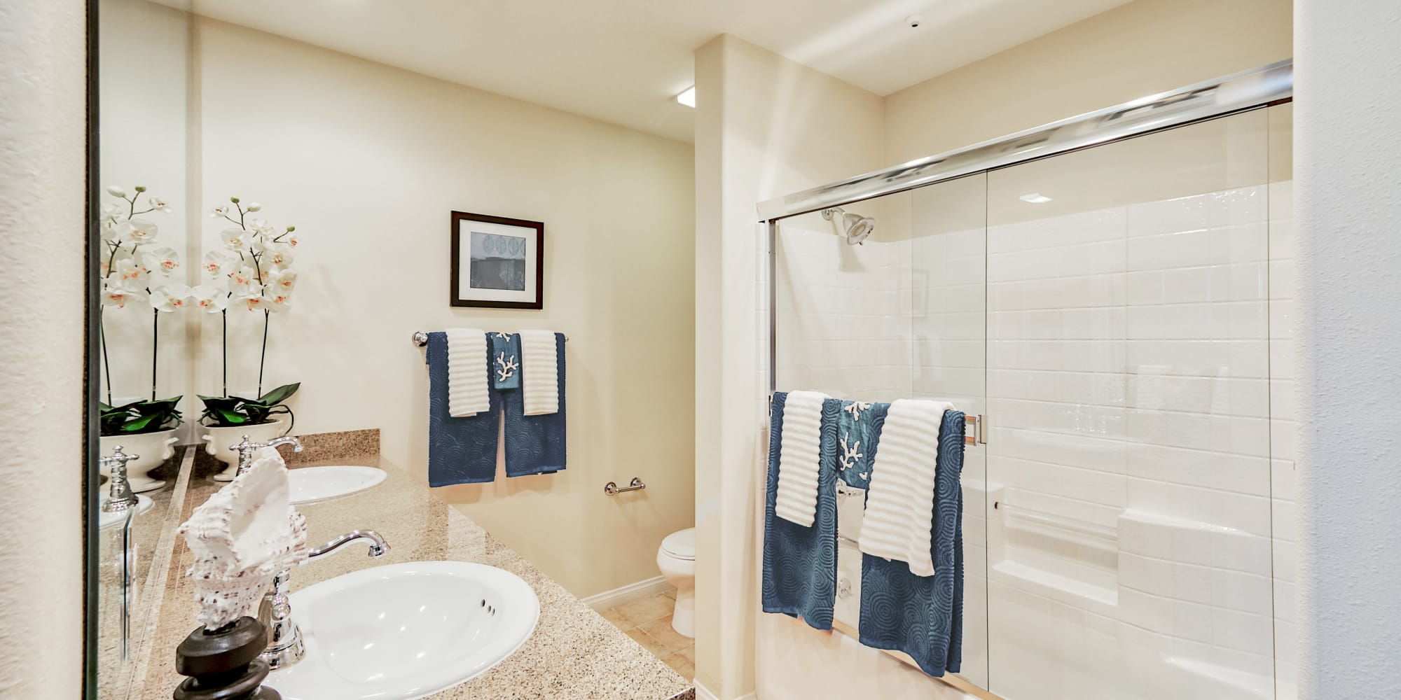 Bathroom with granite counter top and double sinks at The Villa at Marina Harbor in Marina del Rey, California