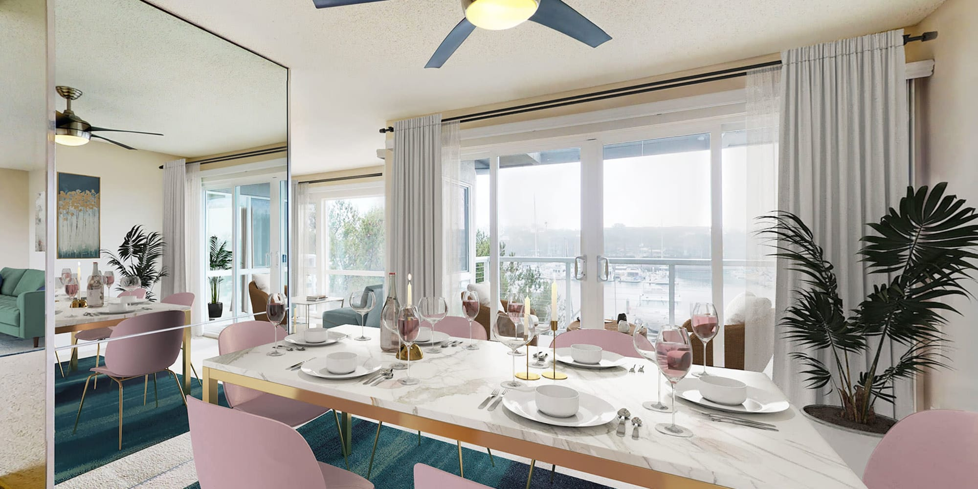 Stylish dining room with expansive waterfront view and balcony in a spacious apartment home at The Tides at Marina Harbor in Marina del Rey, California