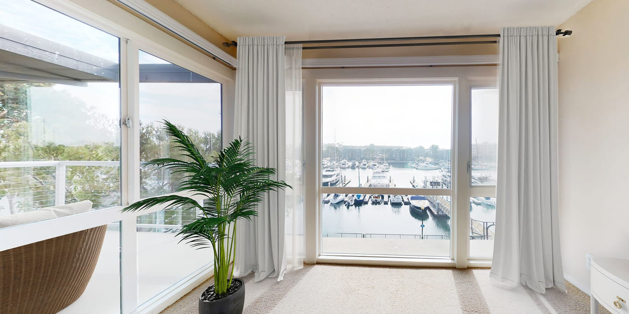 Spacious bedroom with waterfront views of the marina at The Tides at Marina Harbor in Marina del Rey, California