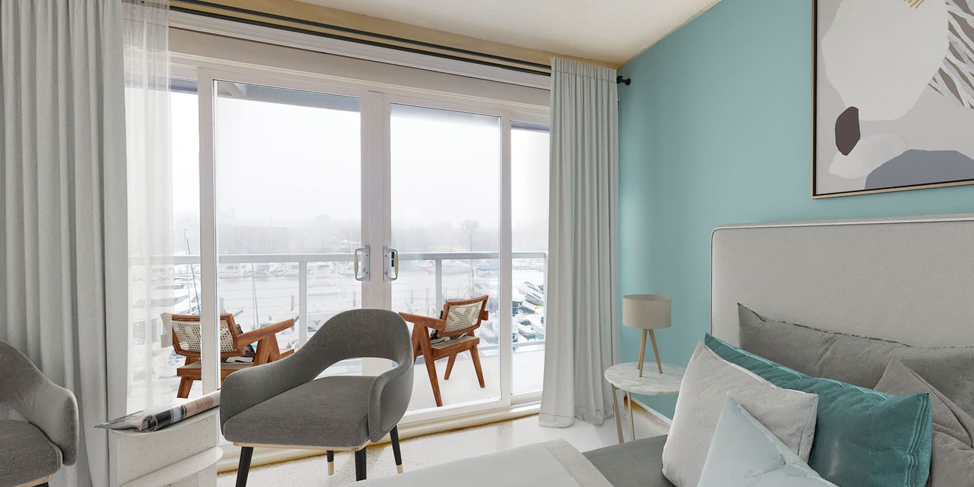 Spacious bedroom with balcony and waterfront views of the marina at The Tides at Marina Harbor in Marina del Rey, California