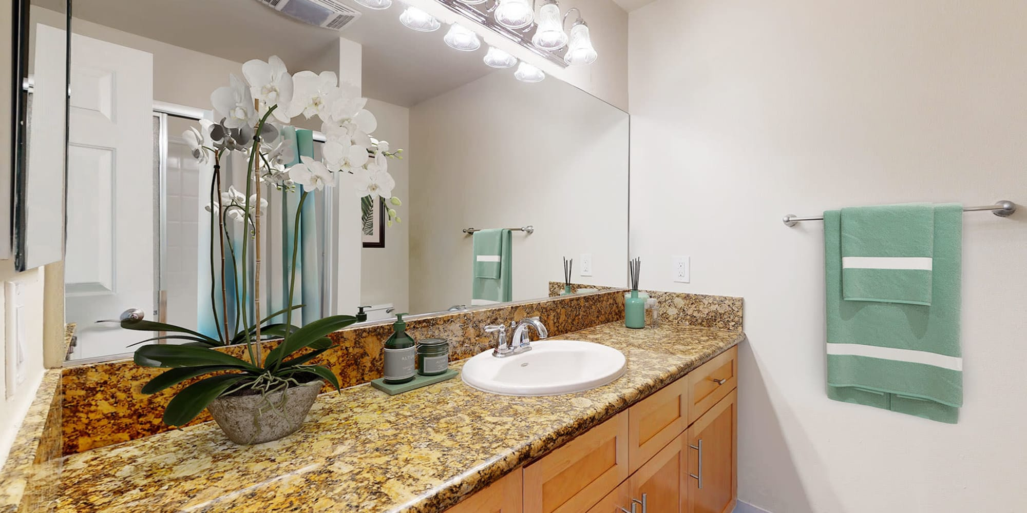 Bathroom with granite countertops in a spacious apartment home at The Tides at Marina Harbor in Marina del Rey, California