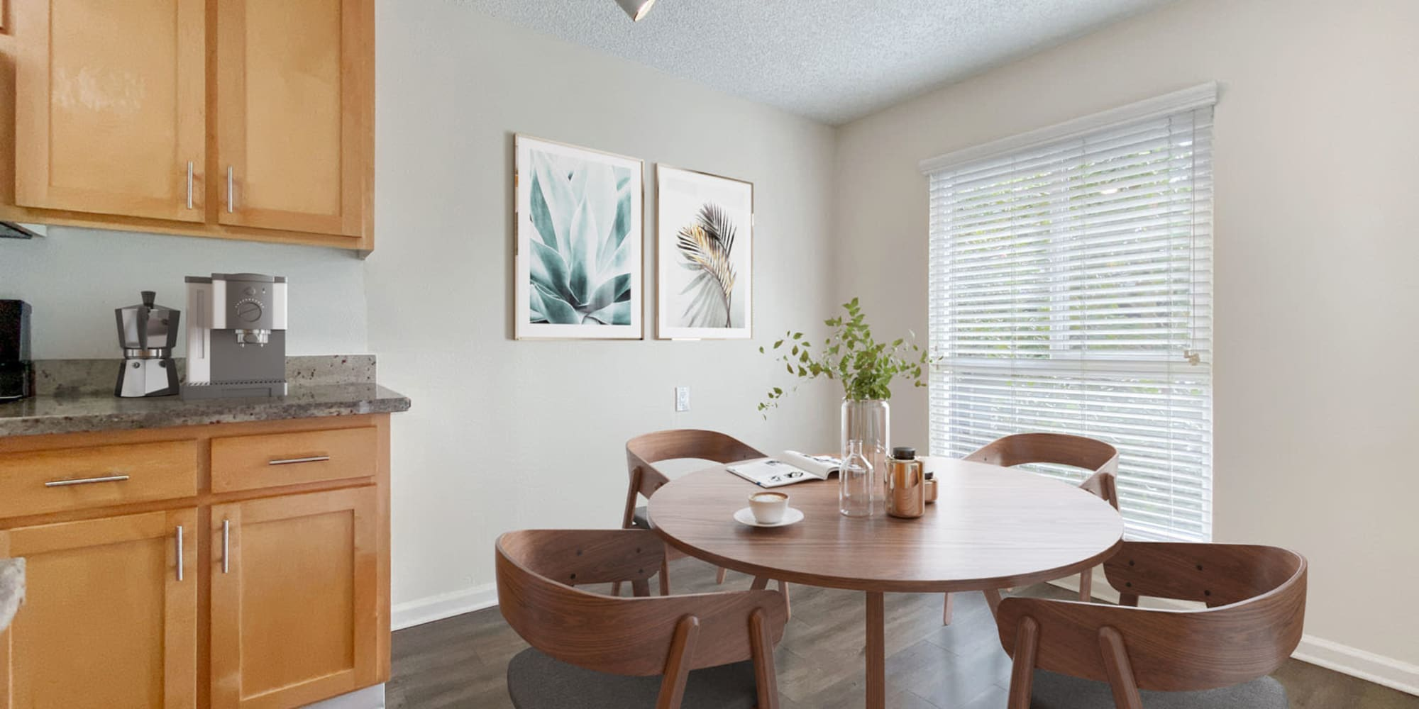 Dining nook next to the kitchen in a model home at Pleasanton Glen Apartment Homes in Pleasanton, California