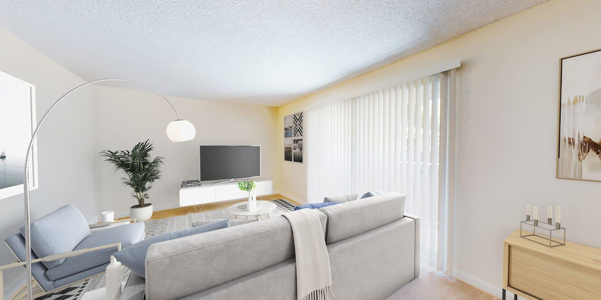 Modern furnishings in the living area of a model apartment at Pleasanton Glen Apartment Homes in Pleasanton, California