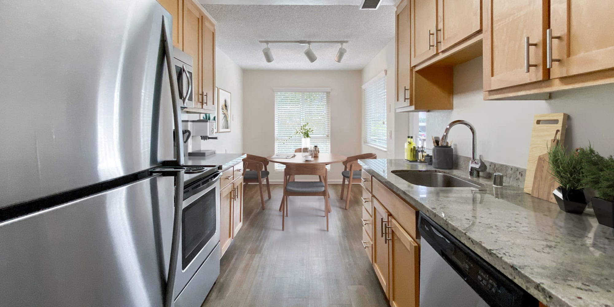 Granite countertops and stainless-steel appliances in a model home at Pleasanton Glen Apartment Homes in Pleasanton, California