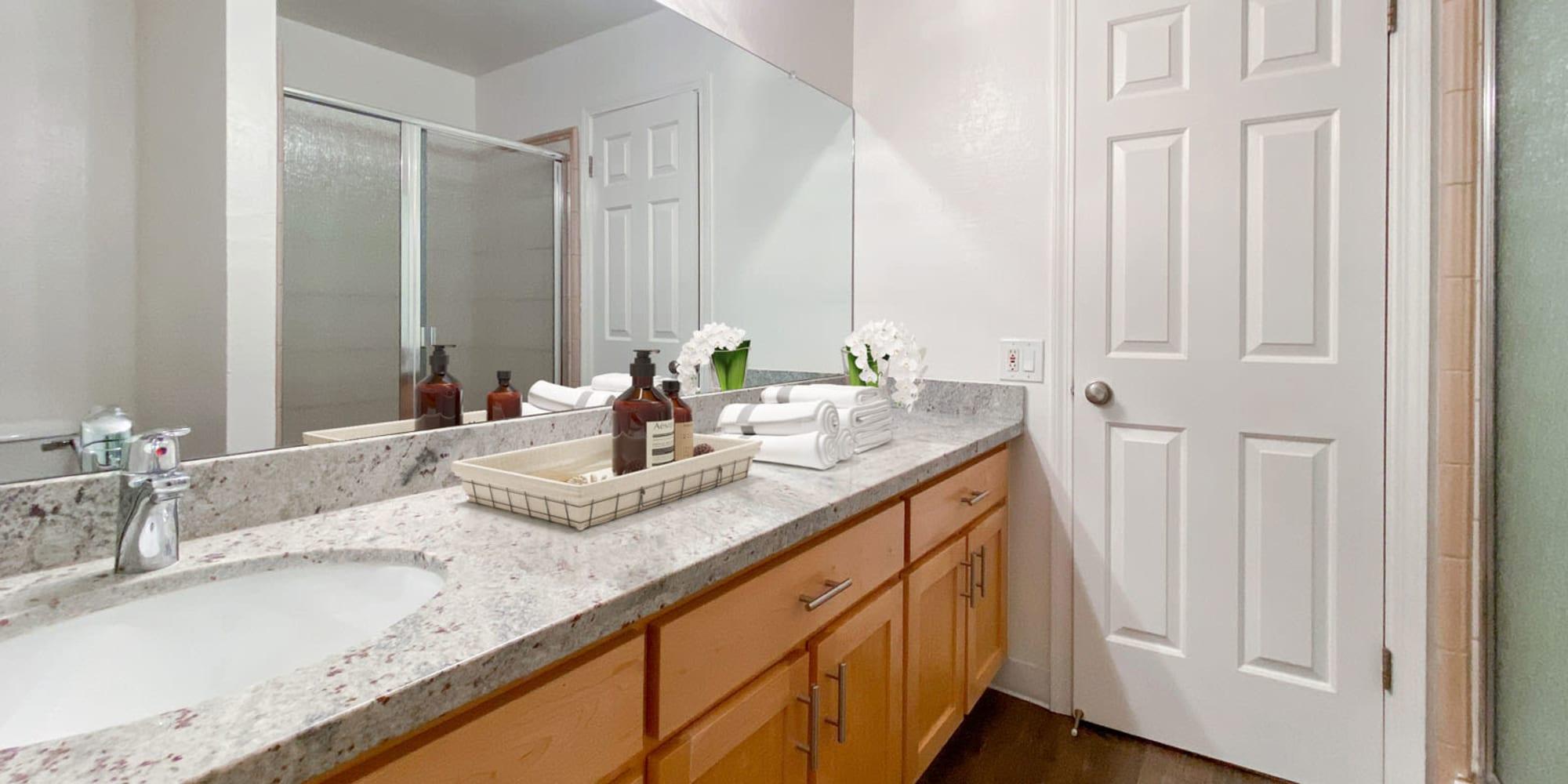 Granite countertop in a model apartment's bathroom at Pleasanton Glen Apartment Homes in Pleasanton, California