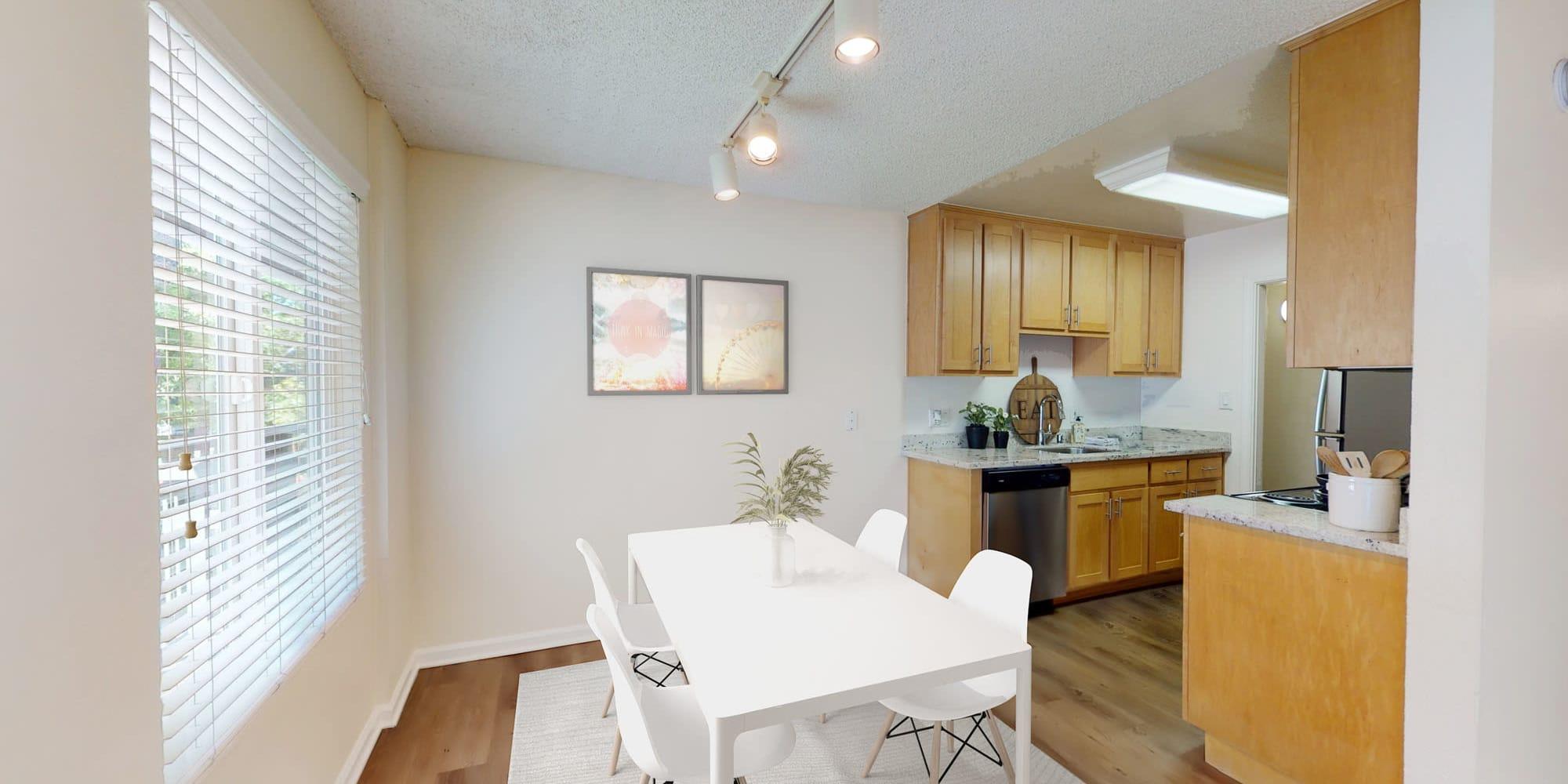 Track lighting above a model home's dining area at Pleasanton Glen Apartment Homes in Pleasanton, California