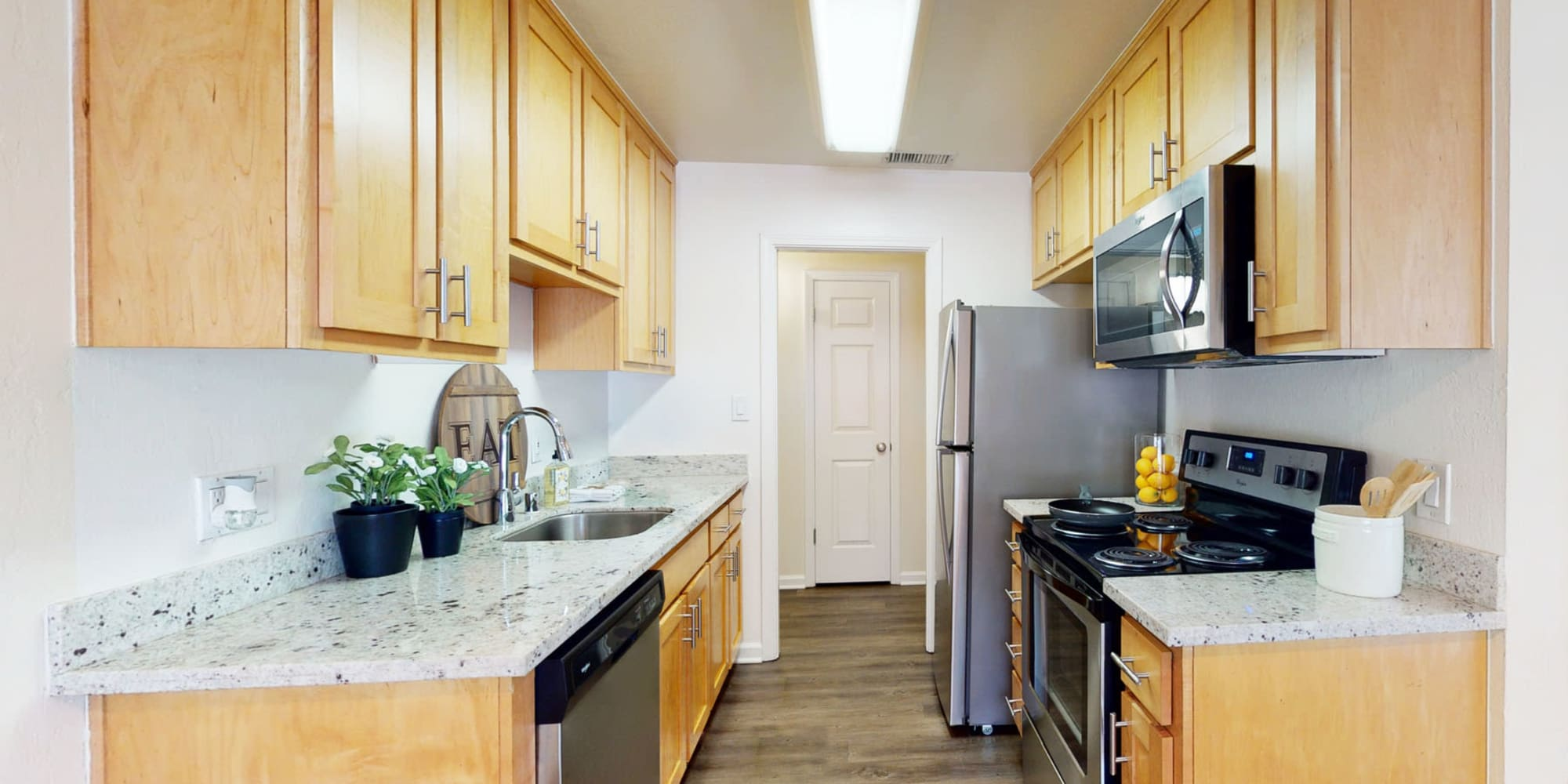 Ample cupboard and storage space in a model home's kitchen at Pleasanton Glen Apartment Homes in Pleasanton, California