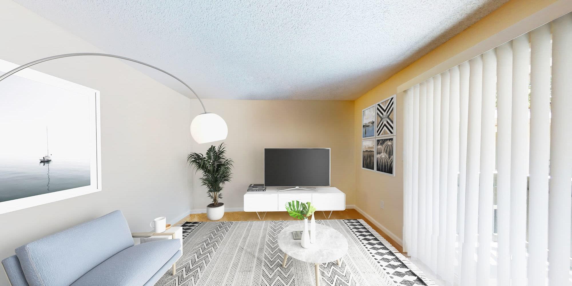 Comfortably furnished model home's living area at Pleasanton Glen Apartment Homes in Pleasanton, California