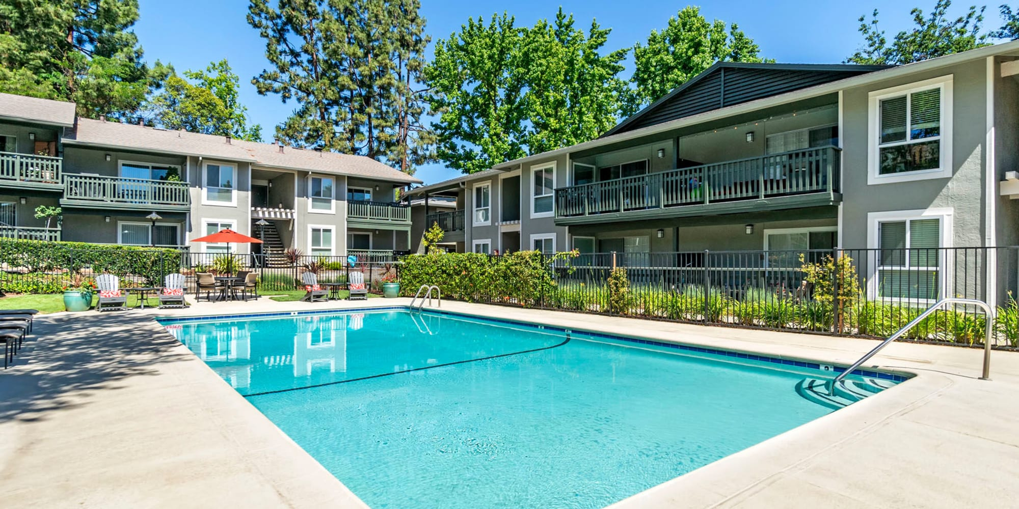Another sunny day at the swimming pool at Pleasanton Glen Apartment Homes in Pleasanton, California