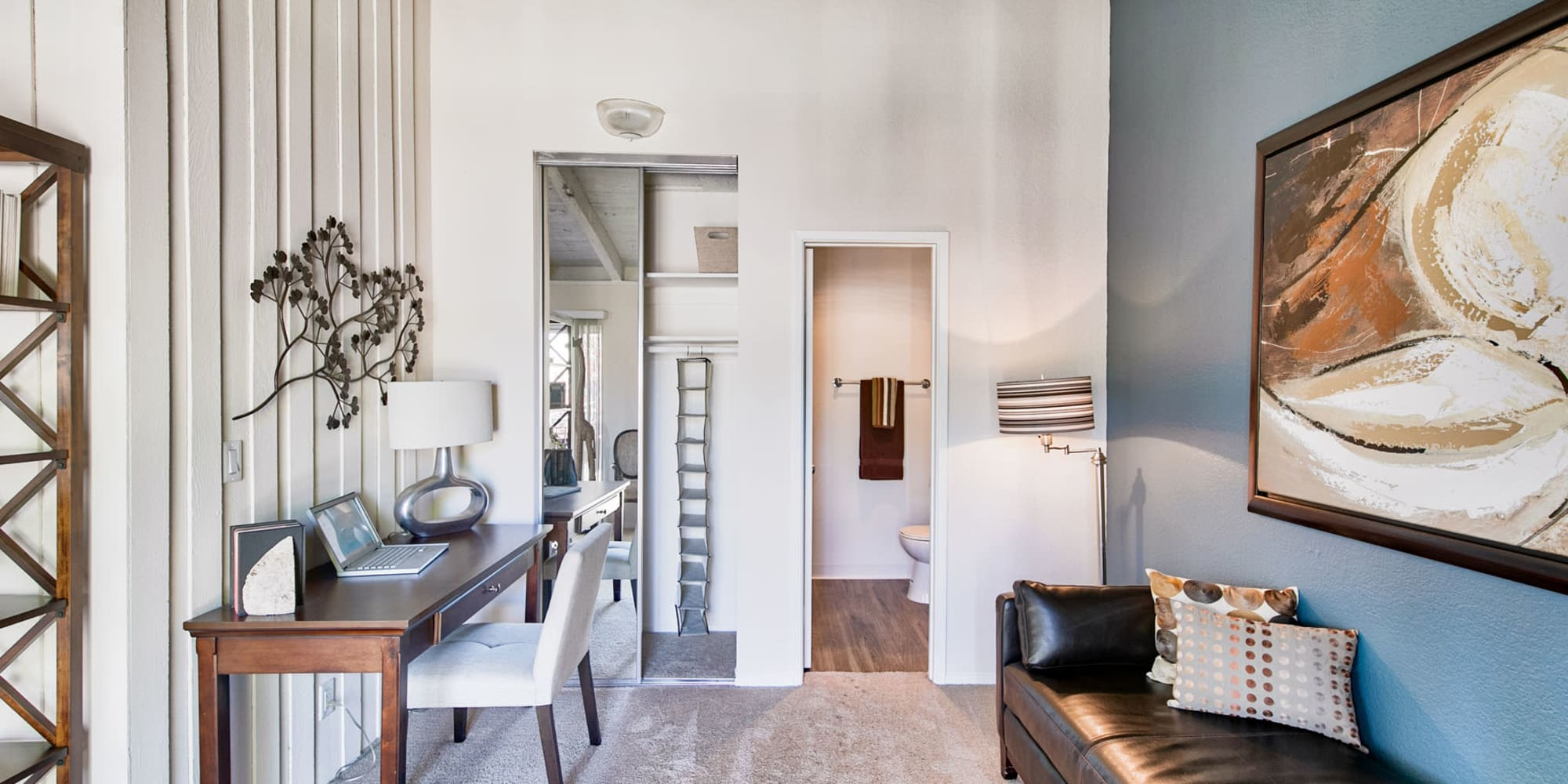 Work nook and an accent wall in a model apartment at Mediterranean Village Apartments in Costa Mesa, California