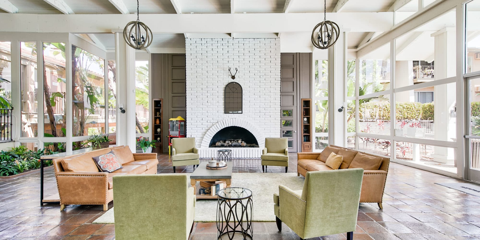 Lounge seating near the fireplace in the resident clubhouse at Mediterranean Village Apartments in Costa Mesa, California