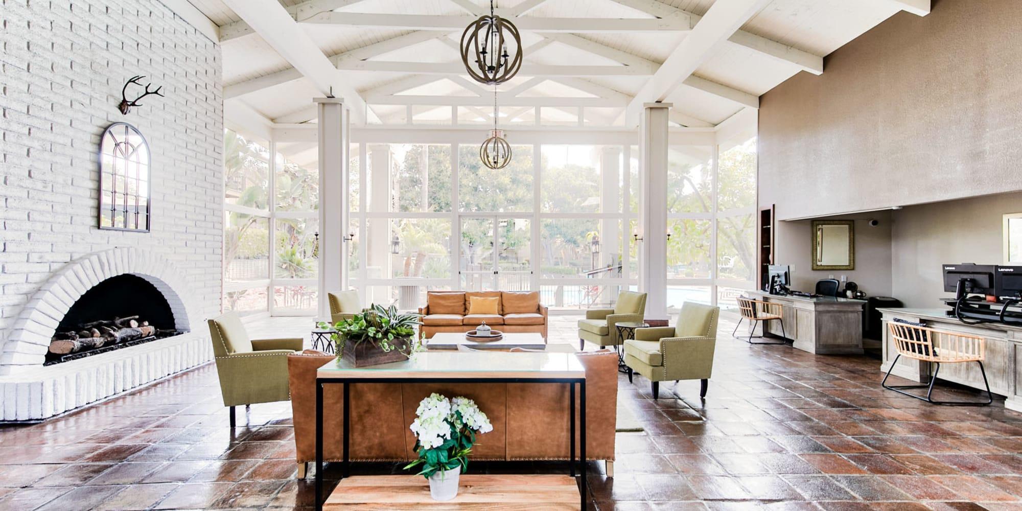 Bright and welcoming lobby interior at Mediterranean Village Apartments in Costa Mesa, California