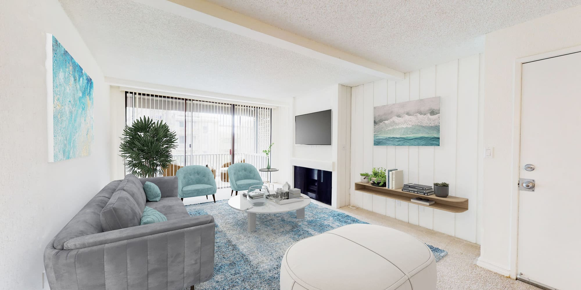 Vaulted ceiling and modern furnishings in a model home's living area at Mariners Village in Marina del Rey, California