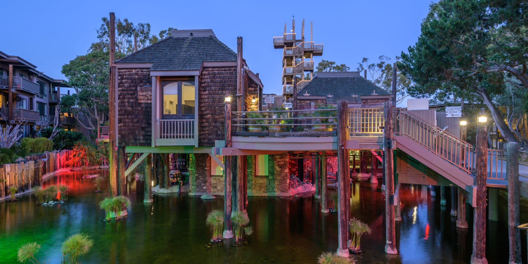 Dusk view of the clubhouse and lagoon at Mariners Village in Marina del Rey, California