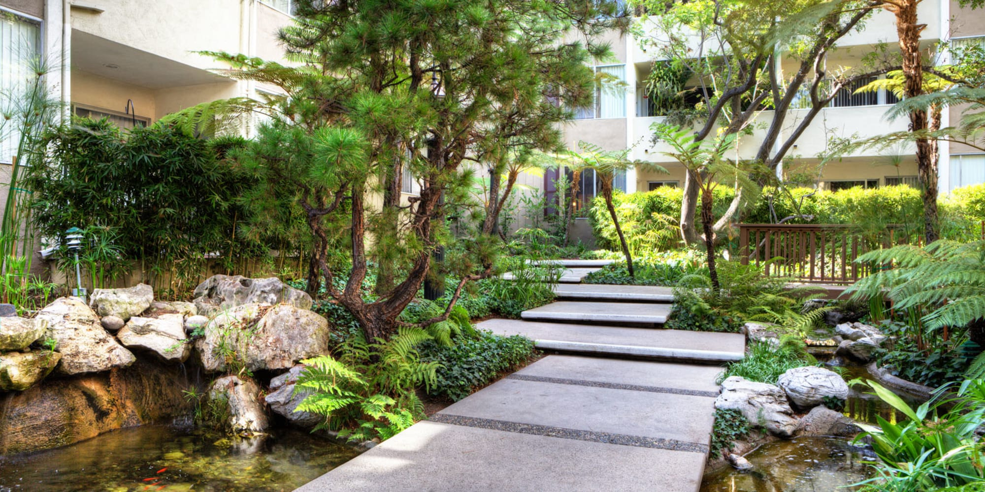 Pathway over a koi pond at Sunset Barrington Gardens in Los Angeles, California