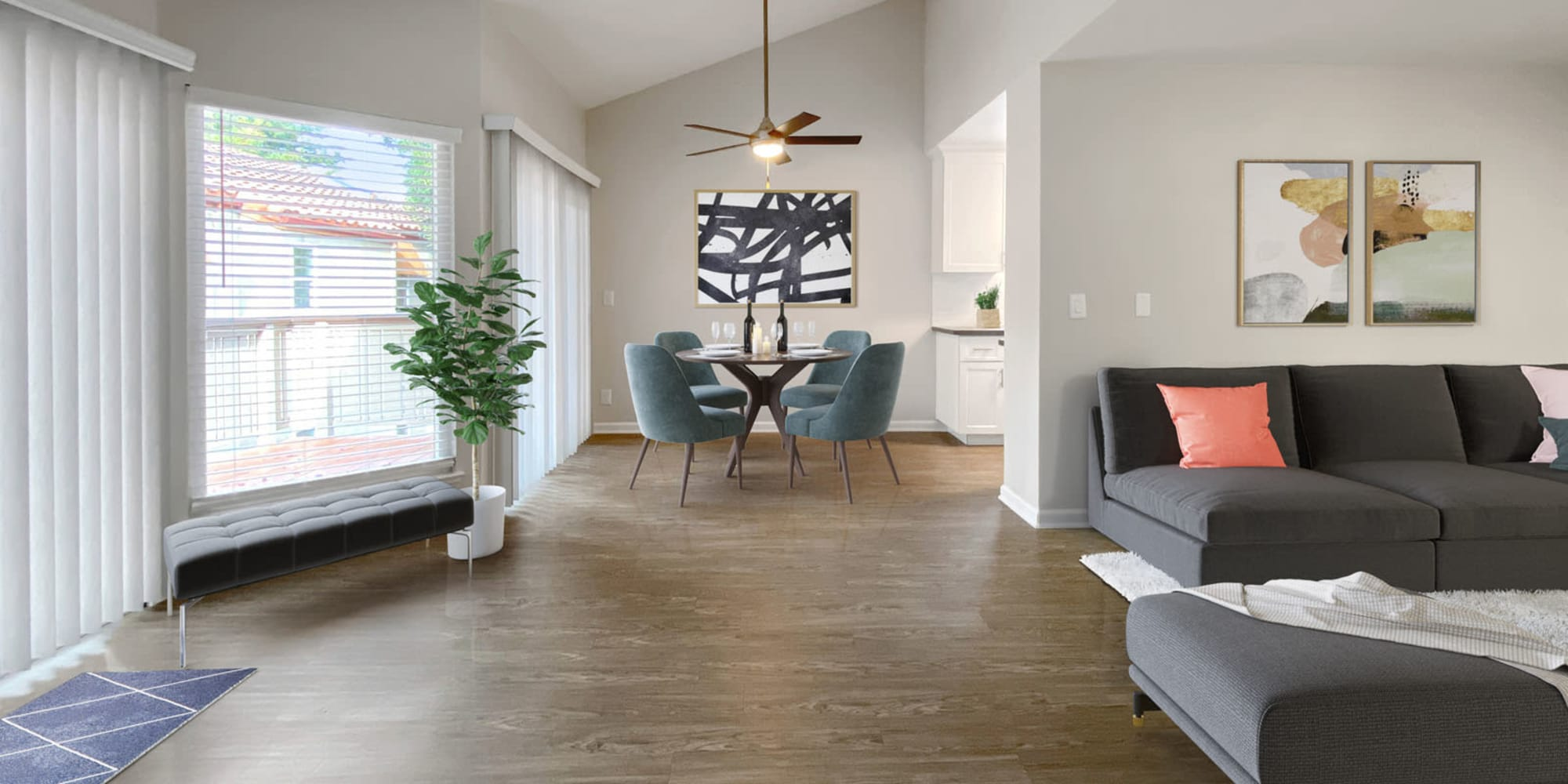 Model home's living area with bay windows and hardwood flooring at Valley Plaza Villages in Pleasanton, California