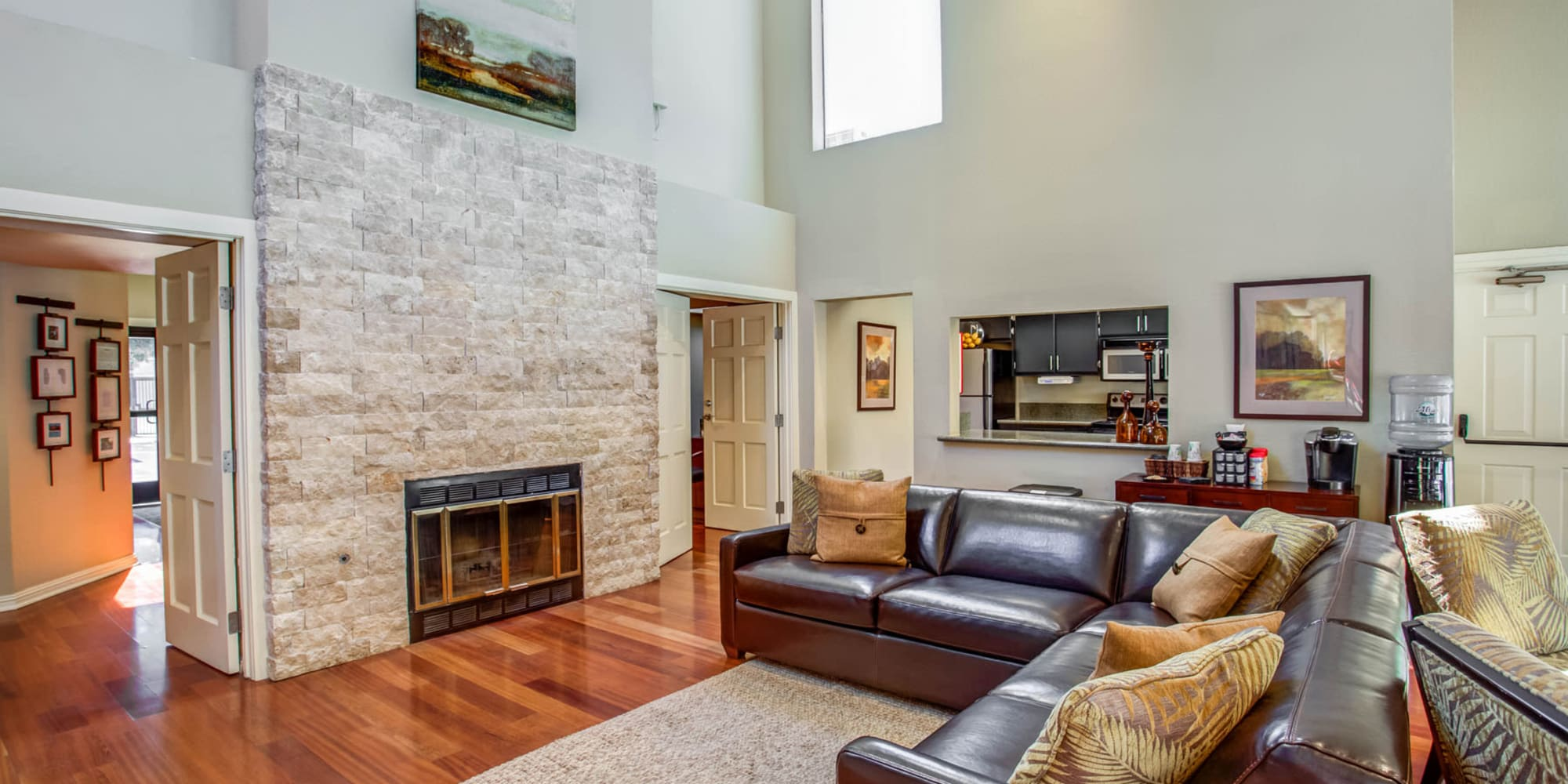 Lounge area in front of the fireplace in the clubhouse at Valley Plaza Villages in Pleasanton, California