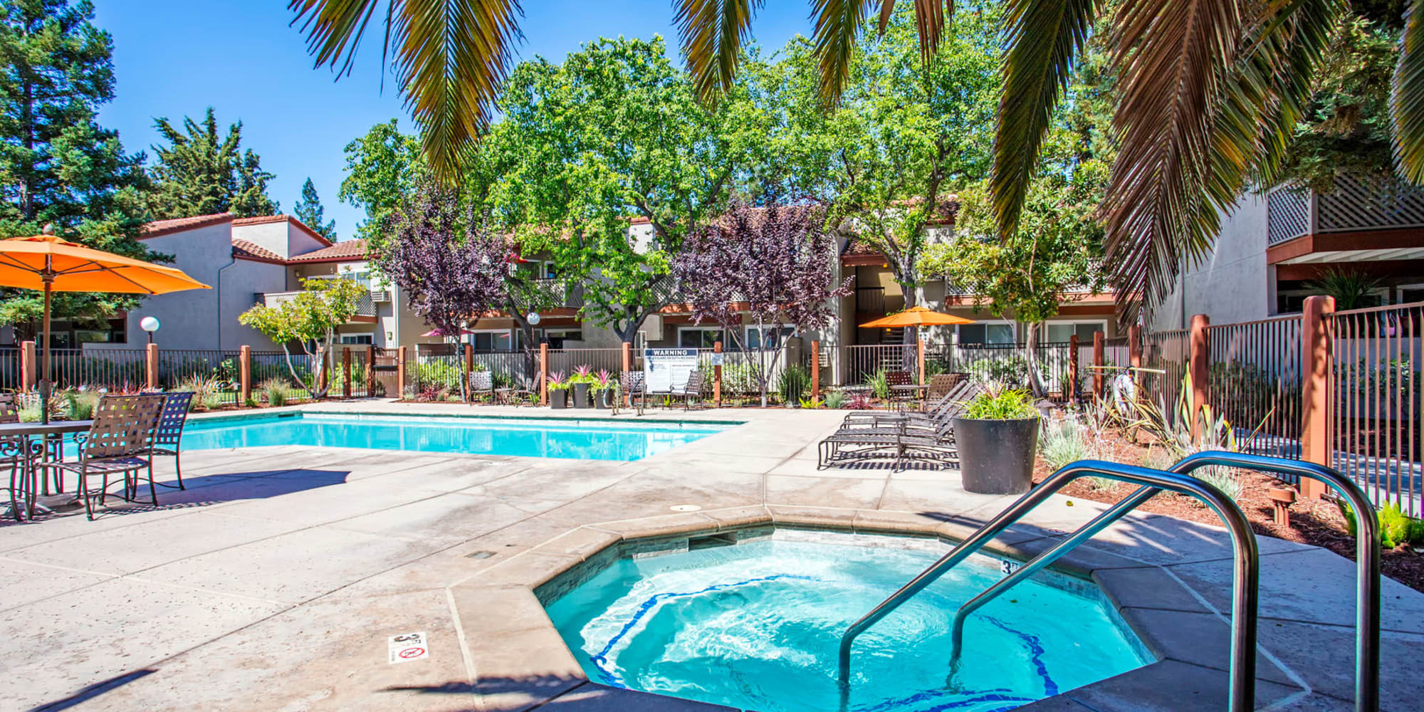 Spa and swimming pool area on a beautiful day at Valley Plaza Villages in Pleasanton, California