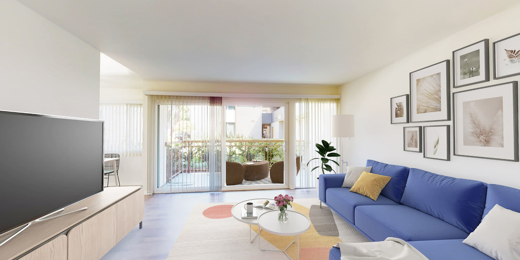 Well-decorated living space in a model two bedroom apartment at West Park Village in Los Angeles, California
