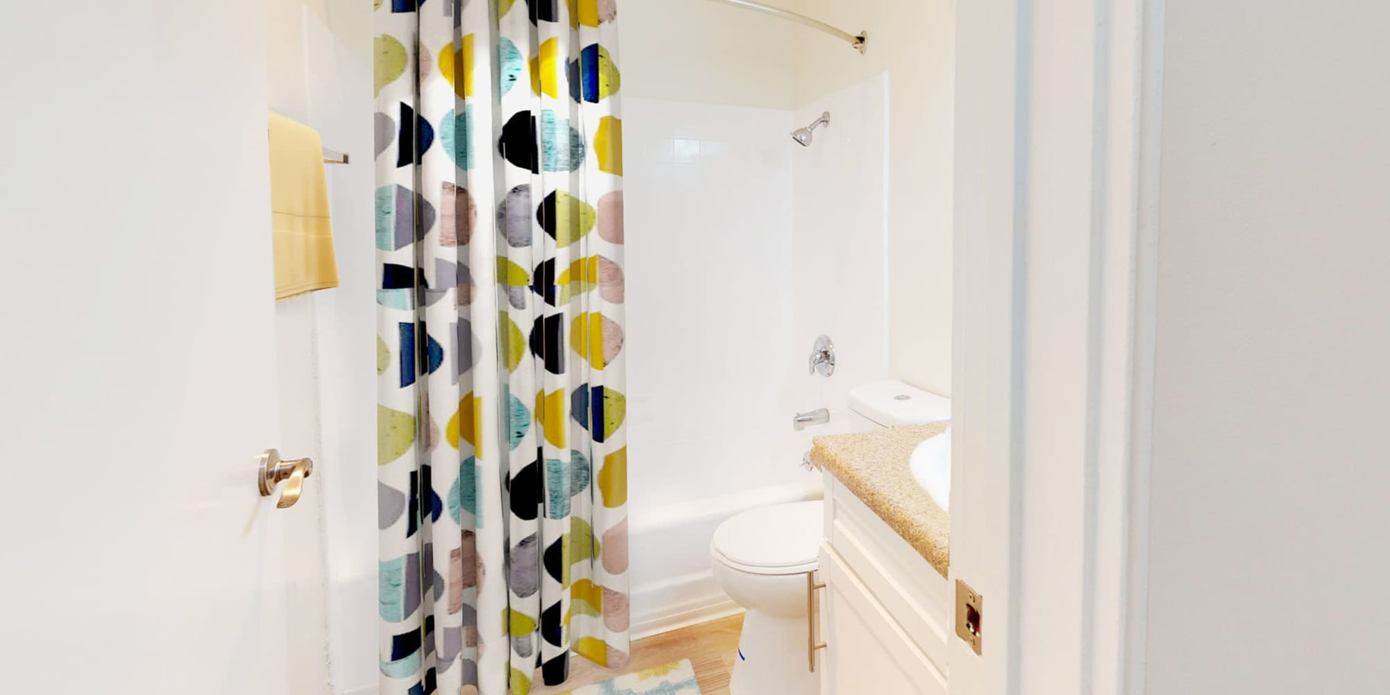 Colorful shower curtain in a model two bedroom home's bathroom at West Park Village in Los Angeles, California