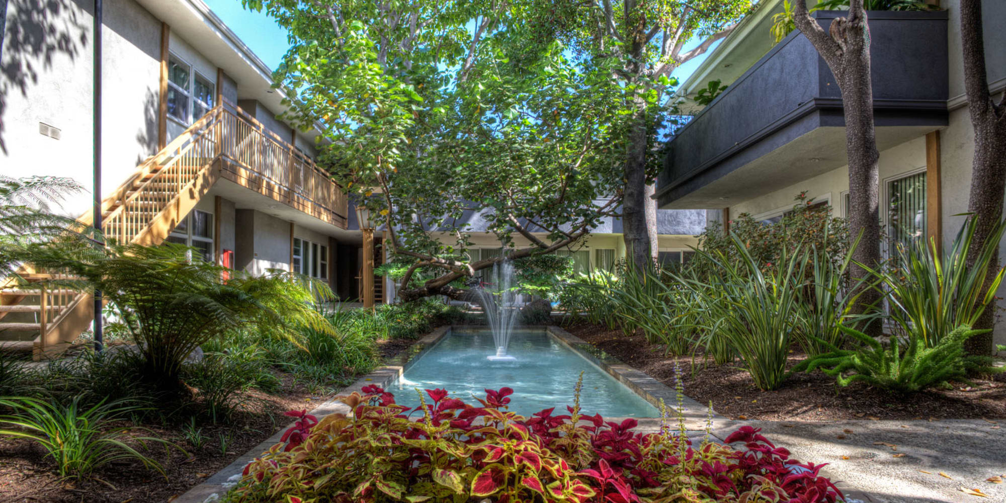 Fountain in a water feature between resident buildings at West Park Village in Los Angeles, California