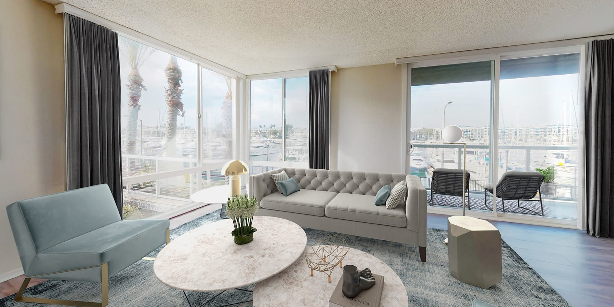 Well-furnished open-concept model home with balcony and views of the marina at Waters Edge at Marina Harbor in Marina Del Rey, California