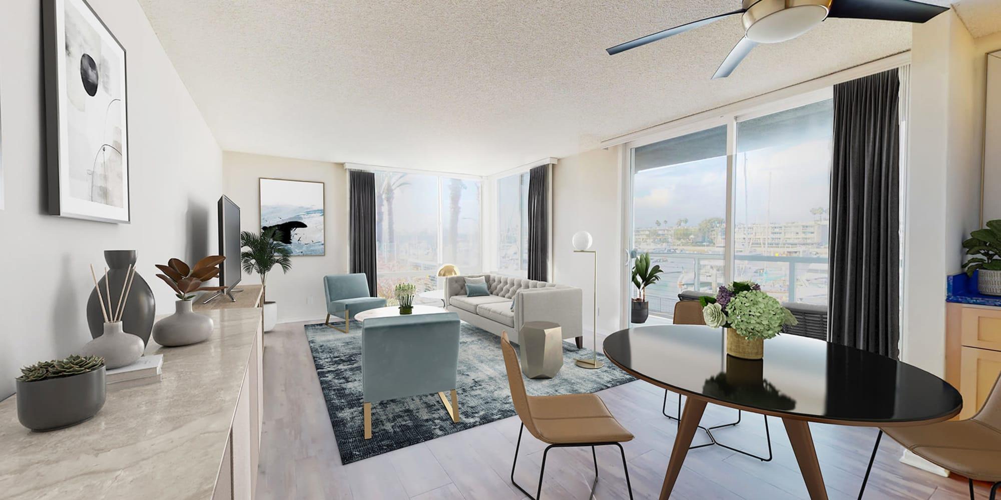 spacious living space with balcony and views of the marina at Waters Edge at Marina Harbor in Marina Del Rey, California