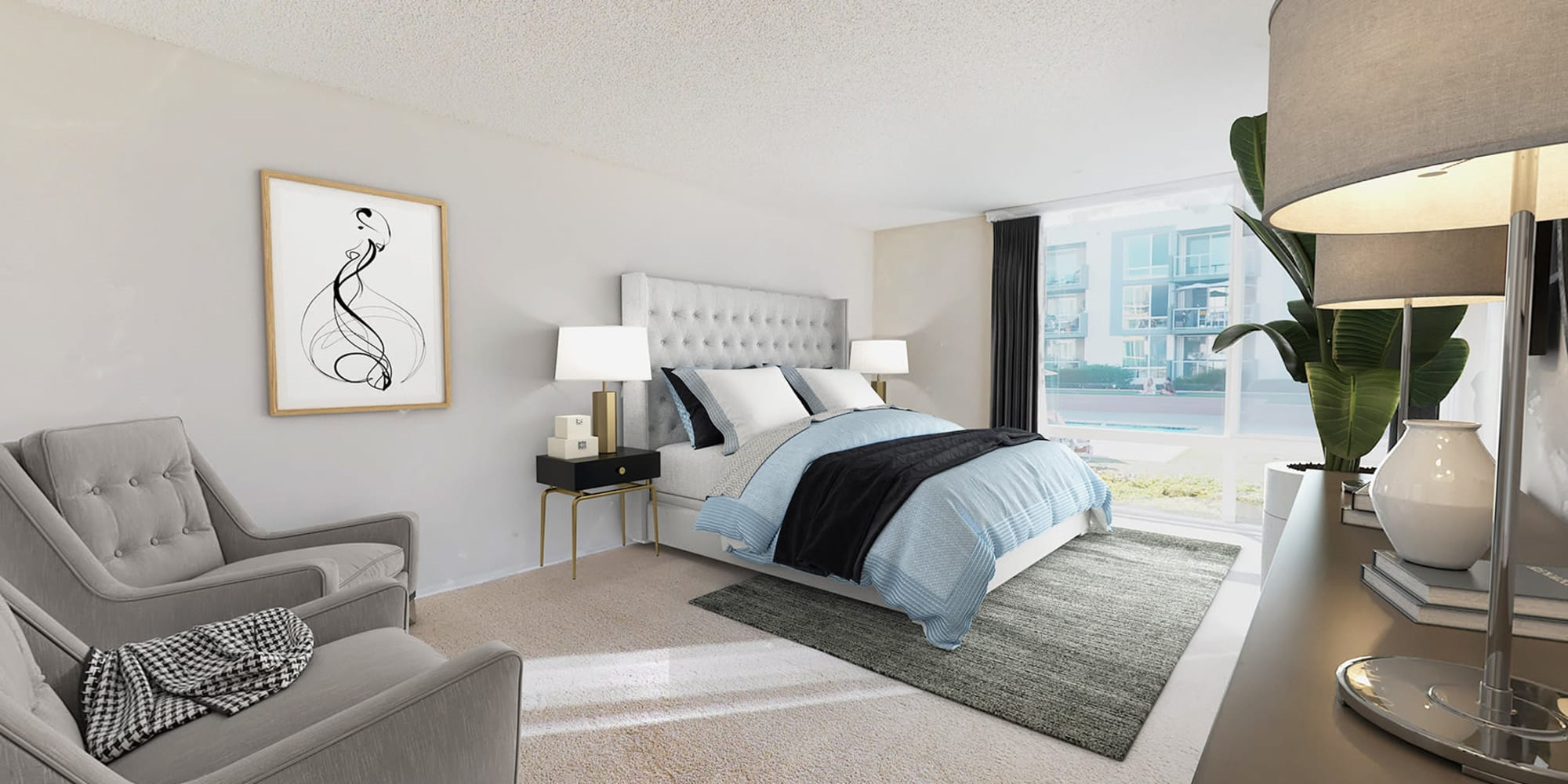 Spacious primary bedroom with plush carpeting and floor-to-ceiling windows at Waters Edge at Marina Harbor in Marina Del Rey, California