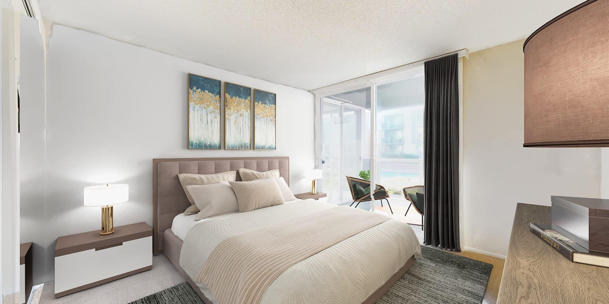 Spacious bedroom with plush carpet and balcony at Waters Edge at Marina Harbor in Marina Del Rey, California