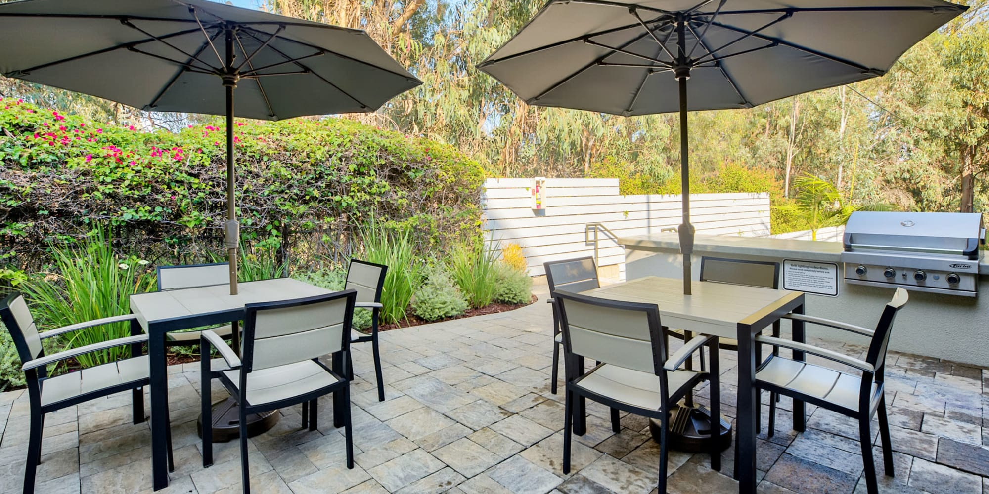 Shaded seating at the barbecue area with gas grills at Casa Granada in Los Angeles, California