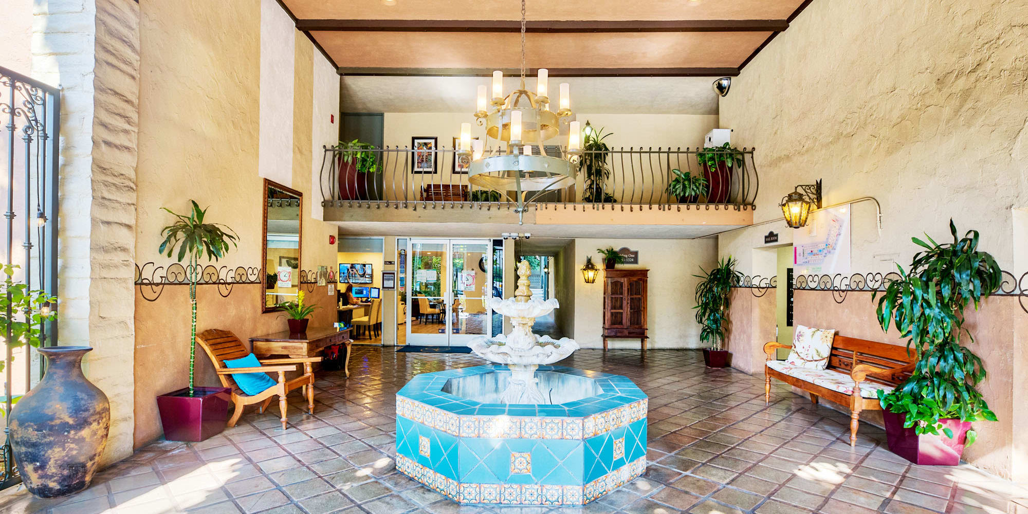 Luxurious fountain in the mission-style lobby at Casa Granada in Los Angeles, California