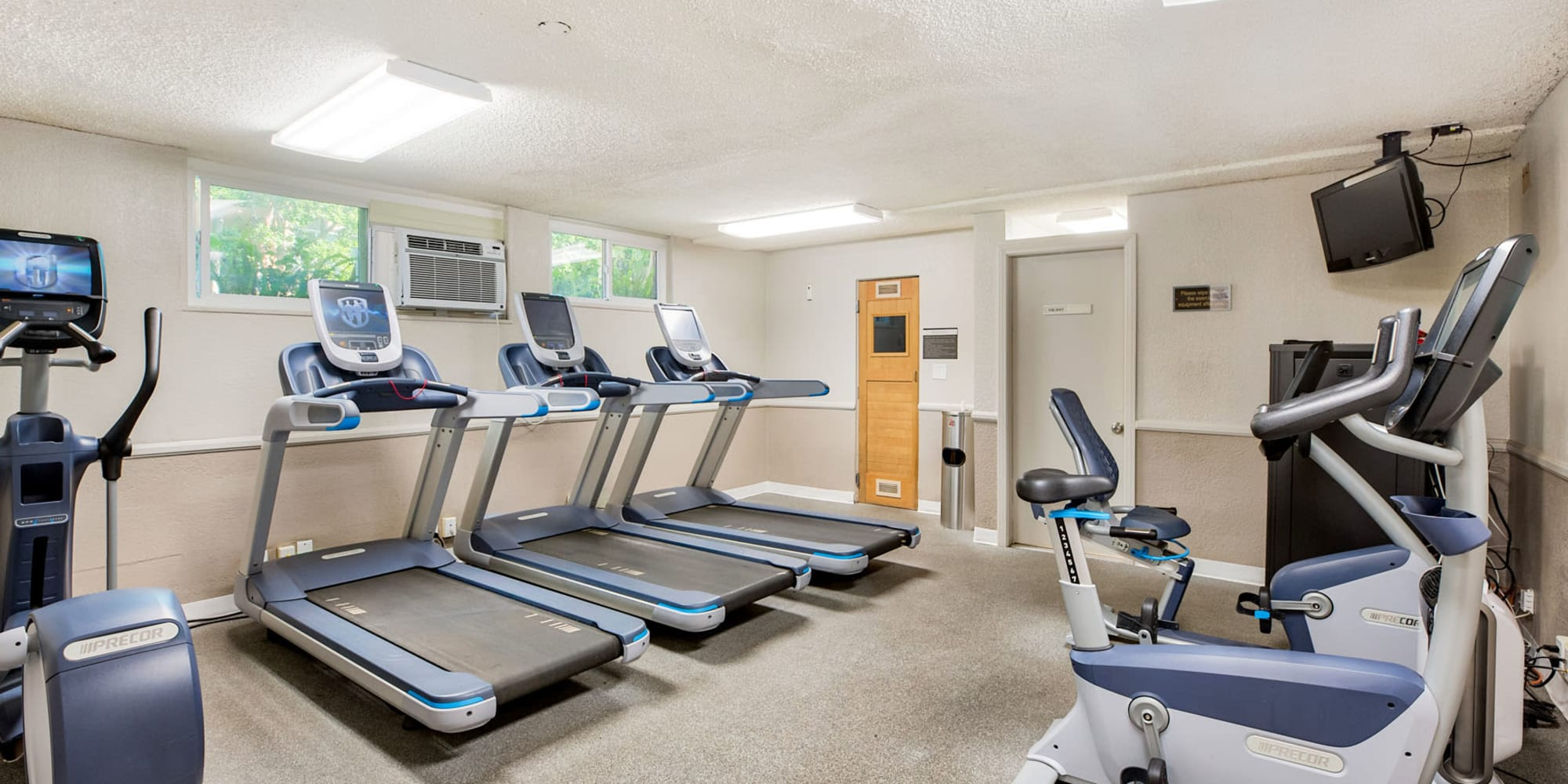 Cardio machines and exercise equipment in the fitness center at Casa Granada in Los Angeles, California
