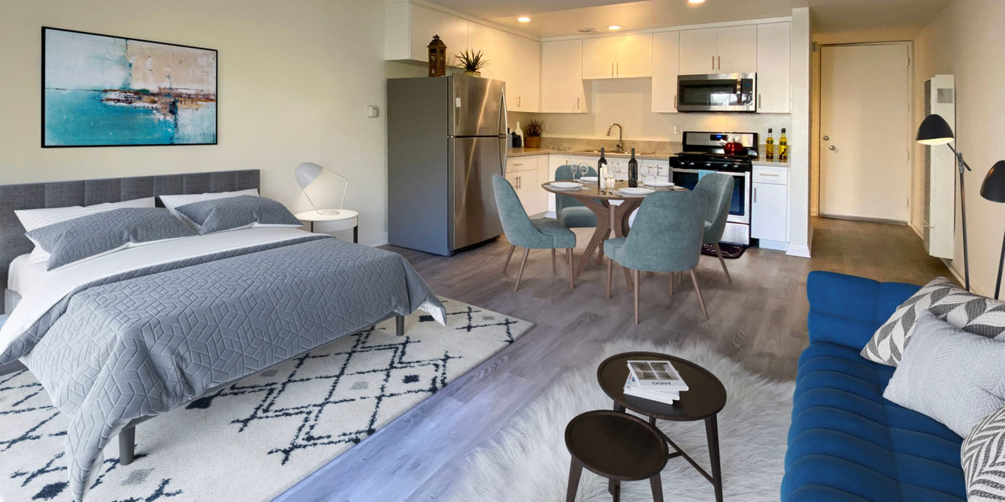 Well-furnished studio apartment with wood-style flooring at Mediterranean Village in West Hollywood, California