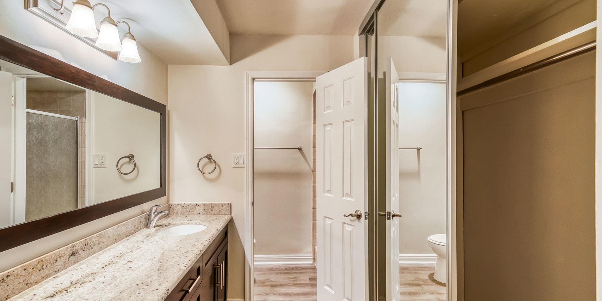 Closet storage in the primary bedroom's en suite bathroom in a model apartment at Mediterranean Village in West Hollywood, California