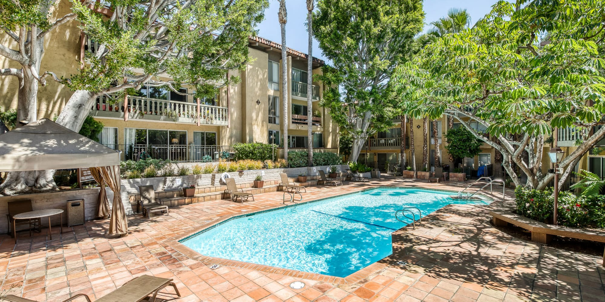 Beautiful day at the resort-style swimming pool at Mediterranean Village in West Hollywood, California