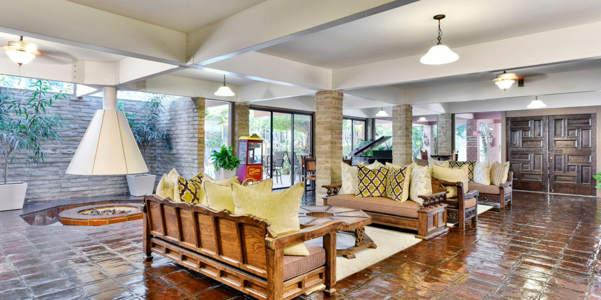 Mediterranean-style decor and a fire pit in the resident clubhouse at Mediterranean Village in West Hollywood, California