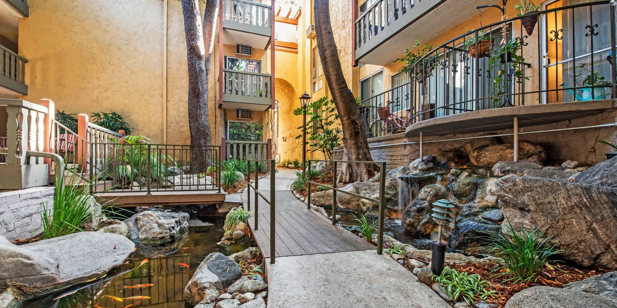 Private balconies overlooking a koi pond at Mediterranean Village in West Hollywood, California