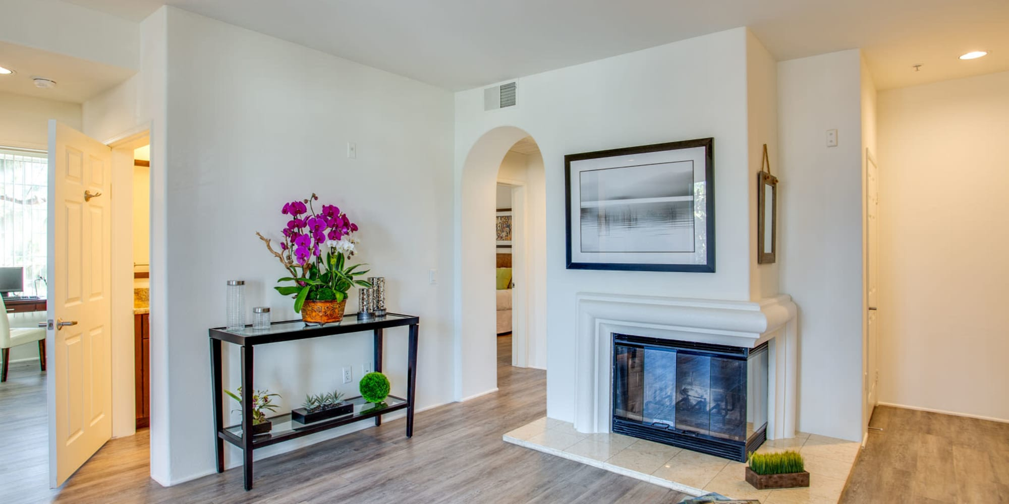 Artwork hung above the fireplace in a model home's living area at L'Estancia in Studio City, California