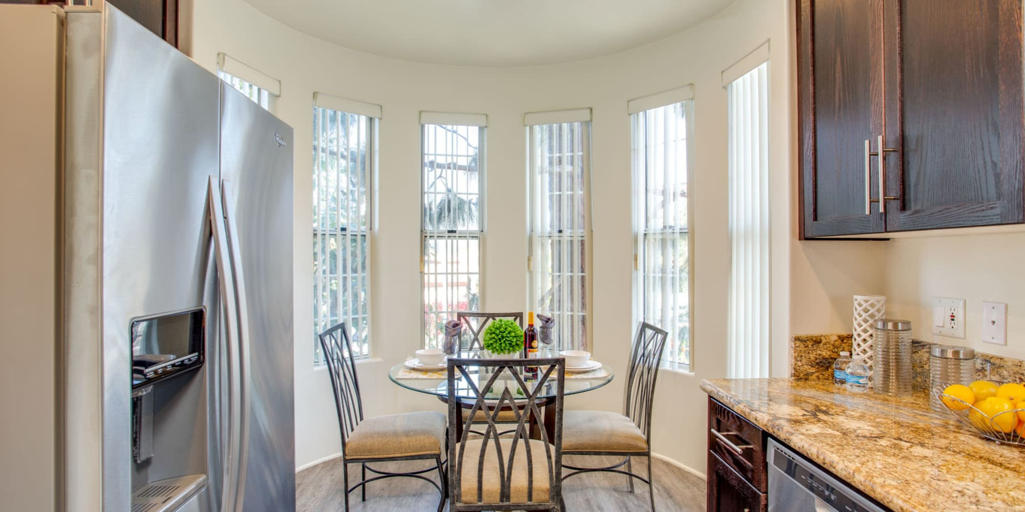 Dining rotunda with vertical windows next to the kitchen in a model apartment at L'Estancia in Studio City, California