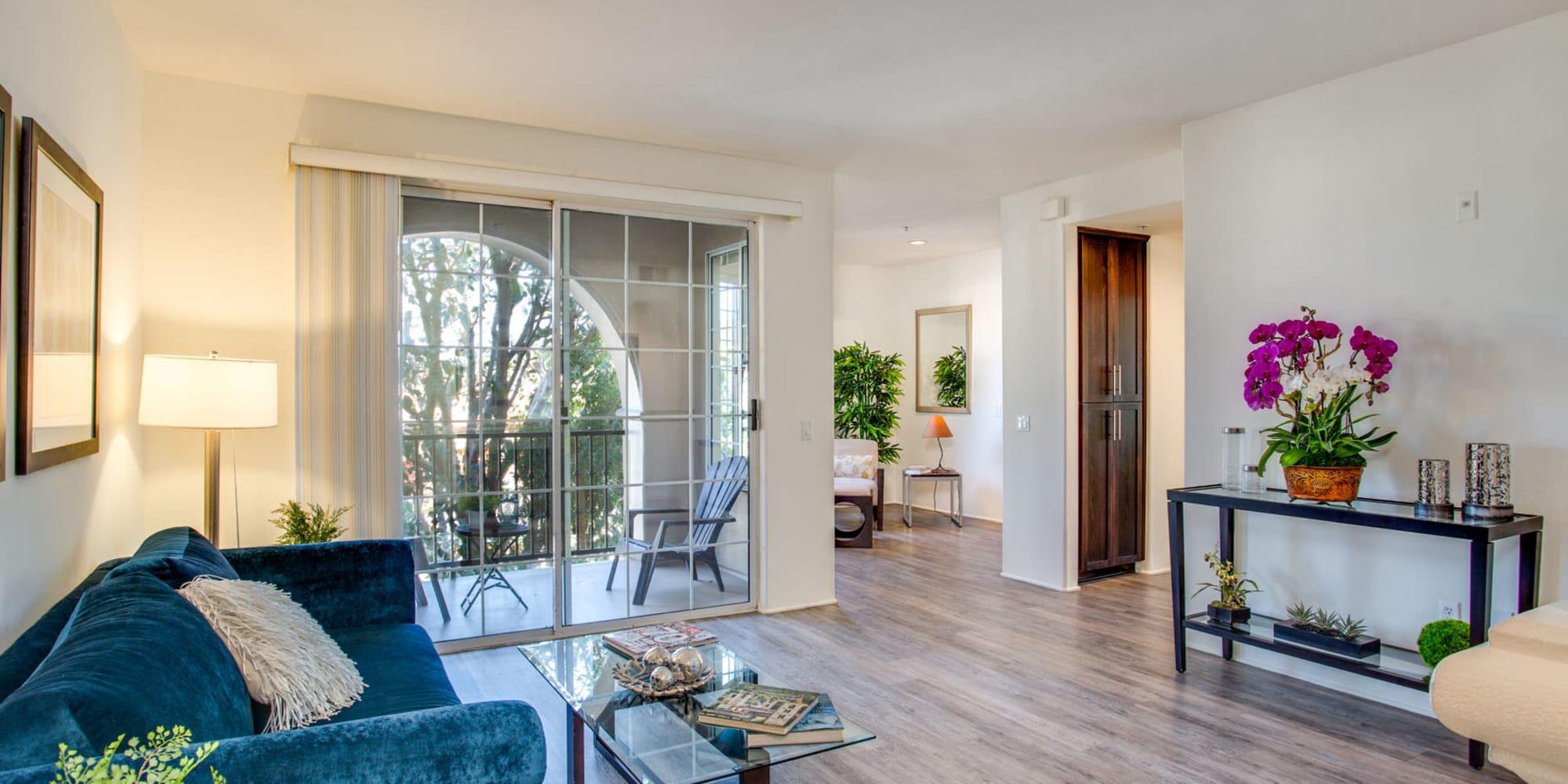 Private balcony outside a model luxury apartment's living area at L'Estancia in Studio City, California