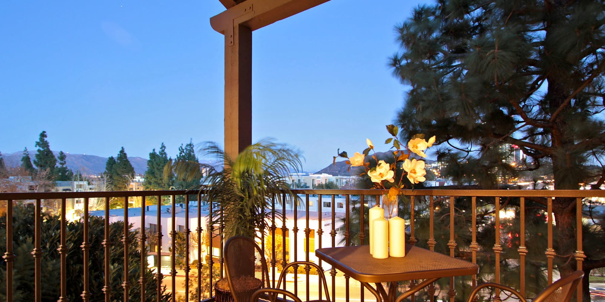 Twilight view of the tranquil community from an apartment home's balcony at L'Estancia in Studio City, California