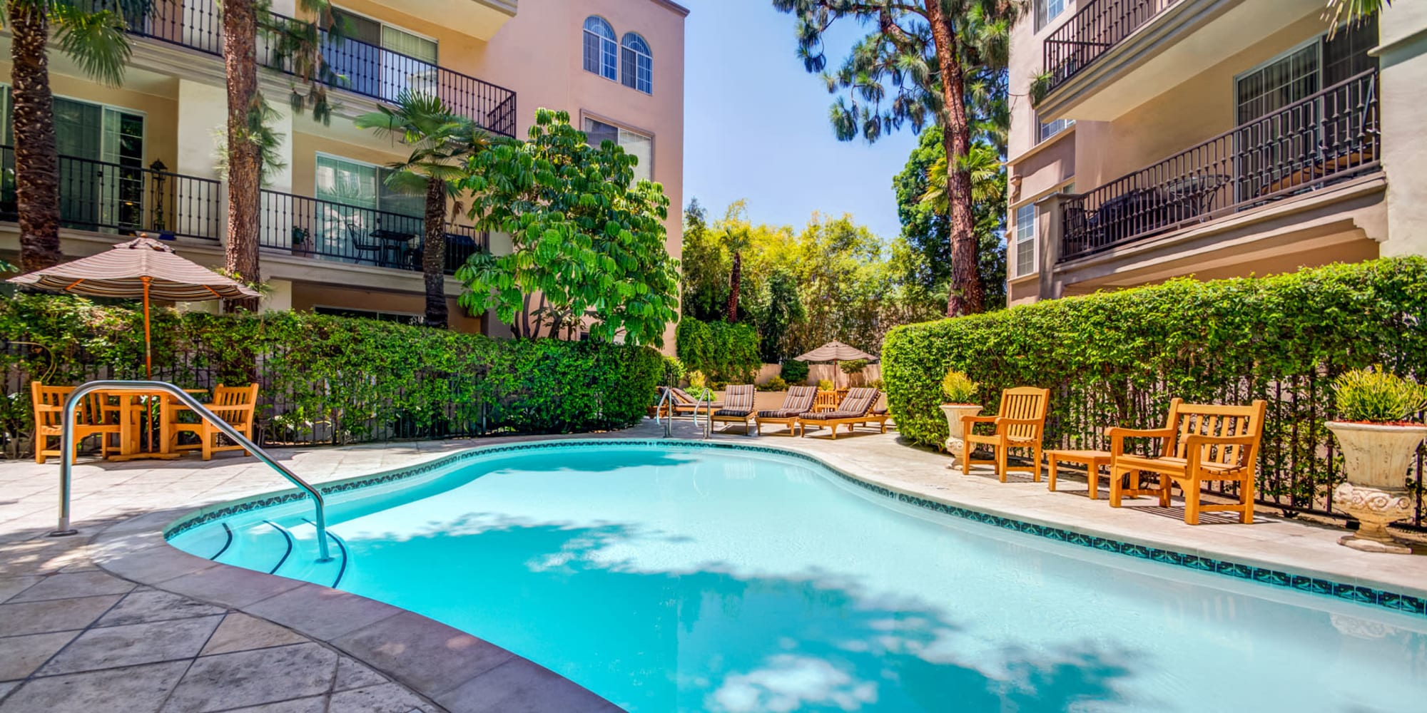 Resort-style swimming pool on a gorgeous day at L'Estancia in Studio City, California