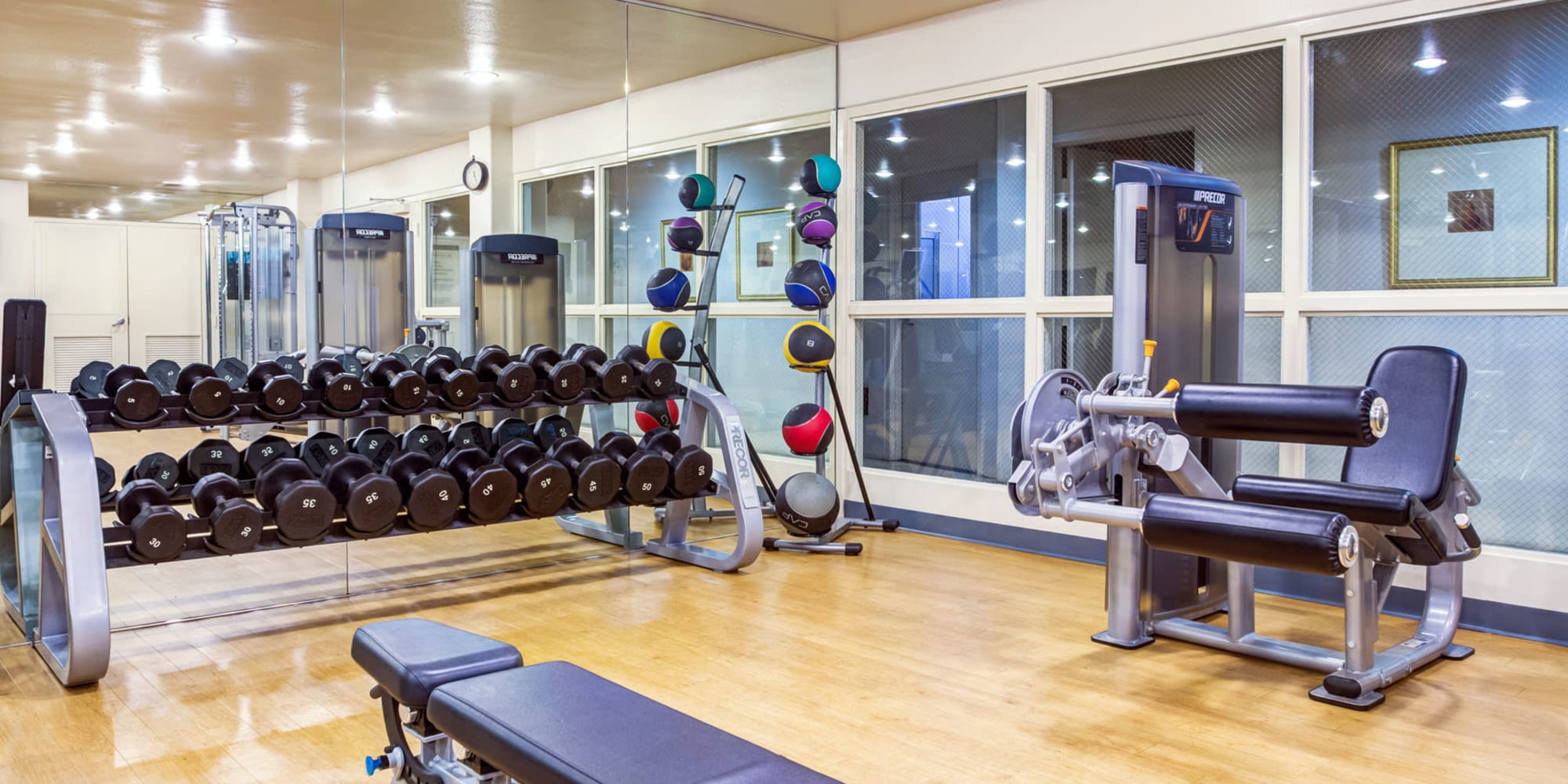 Free weights and exercise workstations in the fitness center and L'Estancia in Studio City, California
