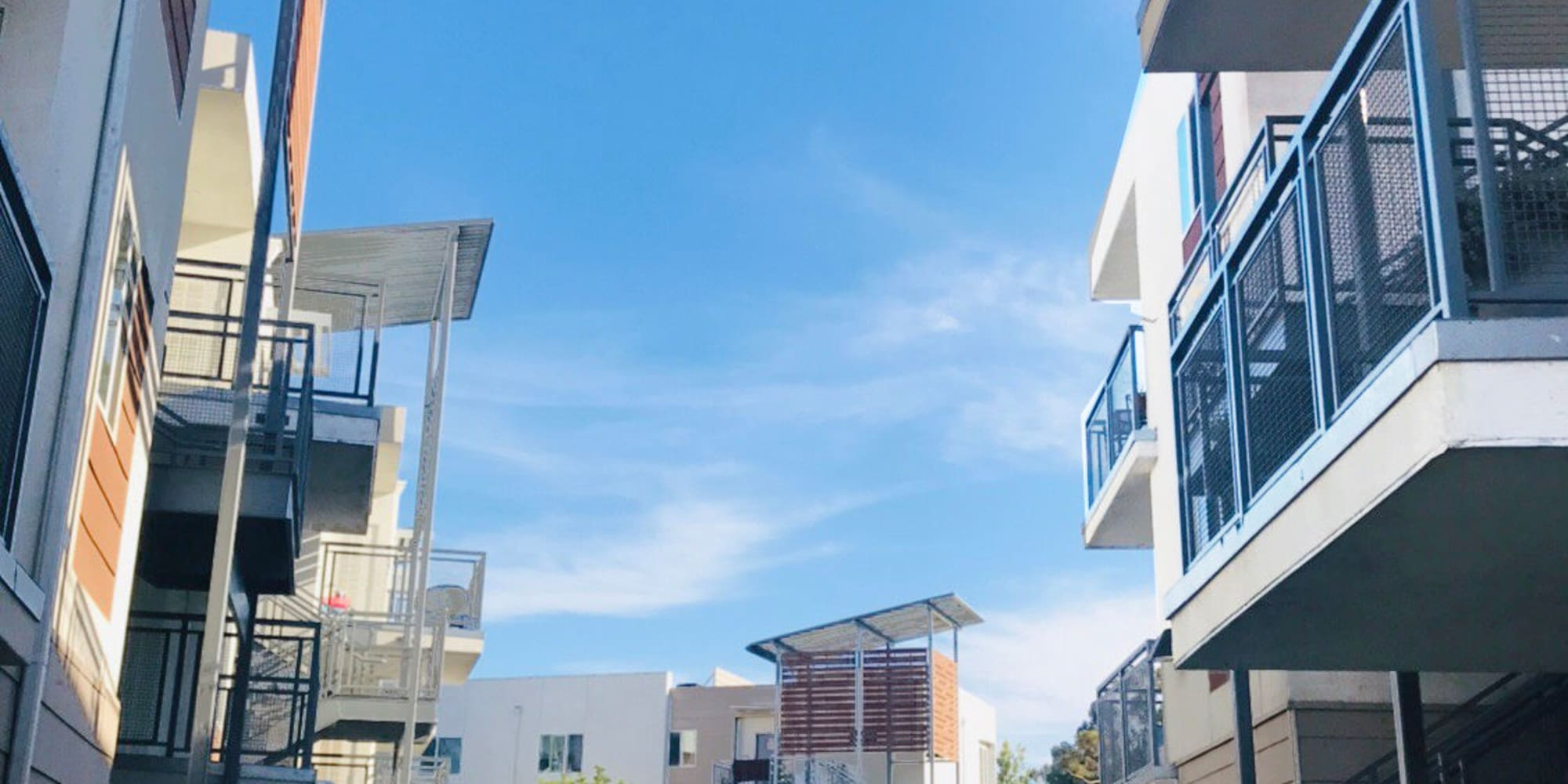 Private balconies outside apartment homes on a beautiful day at Citron in Ventura, California